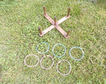 Ring toss game, lawn game, yard game, outdoor game, throwing game, tossing game, camping game, carnival game, outdoor sports, cornhole