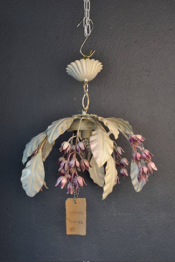 Hanging chandelier with pink flowers