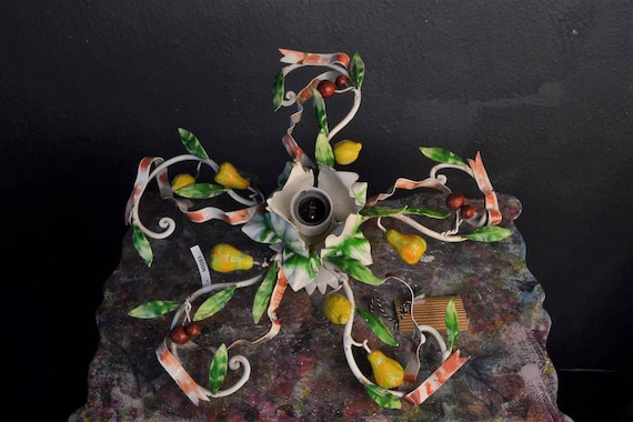 Colourful chandelier with lemons, pears and cherries