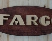 1950 Dodge Fargo Emblem Oval Wall Plaque-Unique scroll saw automotive art created from wood for your garage, shop or man cave.
