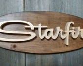 1963 Oldsmobile Starfire Emblem Oval Wall Plaque-Unique scroll saw automotive art created from wood for your garage, shop or man cave.