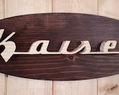 1953 Kaiser Emblem Oval Wall Plaque-Unique scroll saw automotive art created from wood for your garage, shop or man cave.
