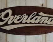 Vintage Overland Emblem Oval Wall Plaque-Unique scroll saw automotive art created from wood.
