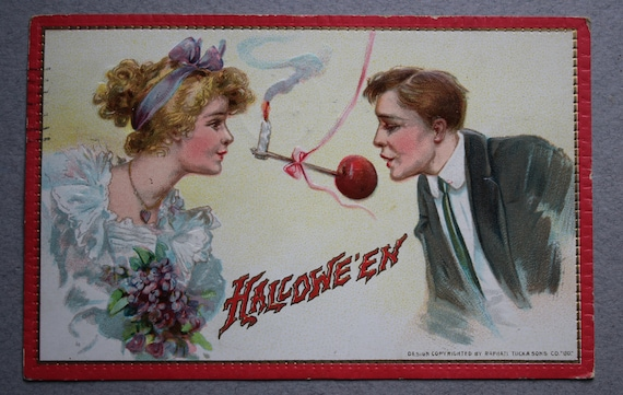 Antique Postcard of Halloween Couple Playing Apple on a String, by Frances Brundage and Raphael Tuck and Sons