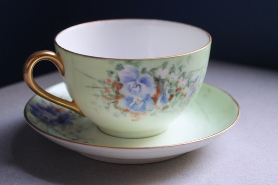 Tresseman and Vogt (T & V), Haviland, Limoges Hand-painted Cup and Saucer with Violet Motif