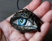 Eye pendant on  black cor...