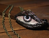 Eye pendant on brass chai...