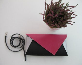 Geometric Leather clutch bag with removable strap. Available in many colors