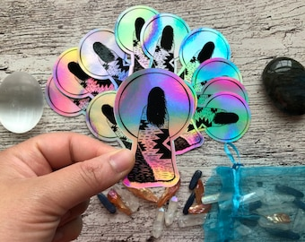She Rises With The Sun : Holographic sticker 3 inches, weather proof