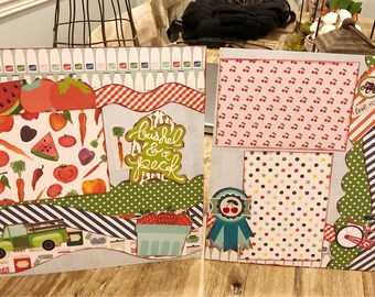Two premade Bushel and a Peck scrapbook pages