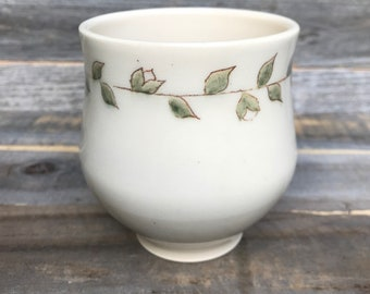 Small cup with budding vine