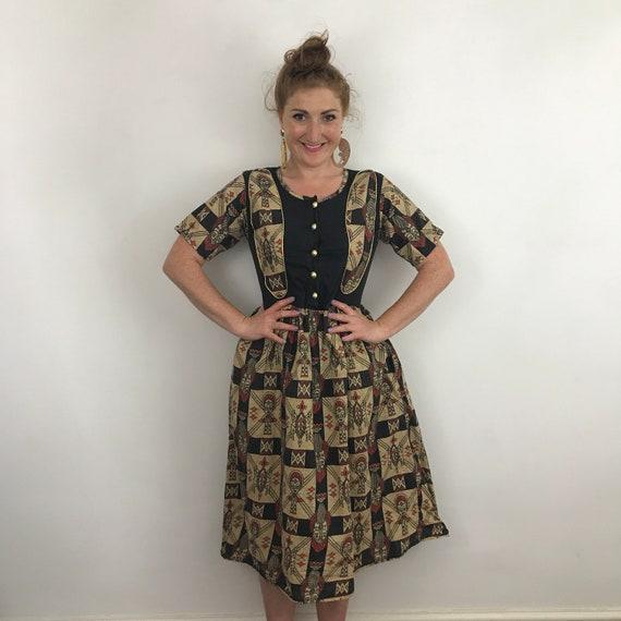 Vintage cotton dress, flared skirt, 1950s style, tribal print, tiki, African mask, totem, gold trim, novelty print, size 12 14, 80s 50s