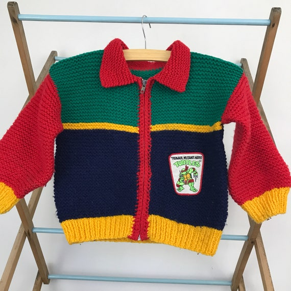 vintage childrens handknit cardigan knitted sweater rainbow turtles handmade knitwear age 3 4 novelty knitting superhero