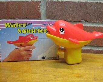 vintage squirt gun water squirter plastic fish hong kong toy