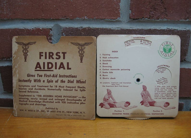 1942 first aidial medical wheel chart vintage aid dial human body