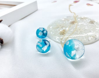Resin blue sky white clouds necklace