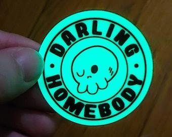 Glow in The Dark Sticker. Weatherproof Darling Homebody Vinyl Decal. Winking Skull Circle Sticker. Spoopy Glow Skull Sticker. Stay Home.