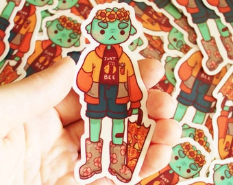 Weatherproof Sticker. Swompy in Rain Boots Sticker. Rainy Day Sticker. Fall Aesthetic Decal. Just Bee Monster Girl Sticker.