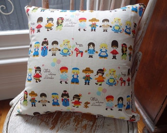 """Children of the world """"Kawaii"""" Print with orange Polka Dots on the backing"""