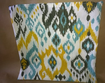 Decorative ikat pattern pillow cover,  size 18 x 18, color white, teal, gold & black..
