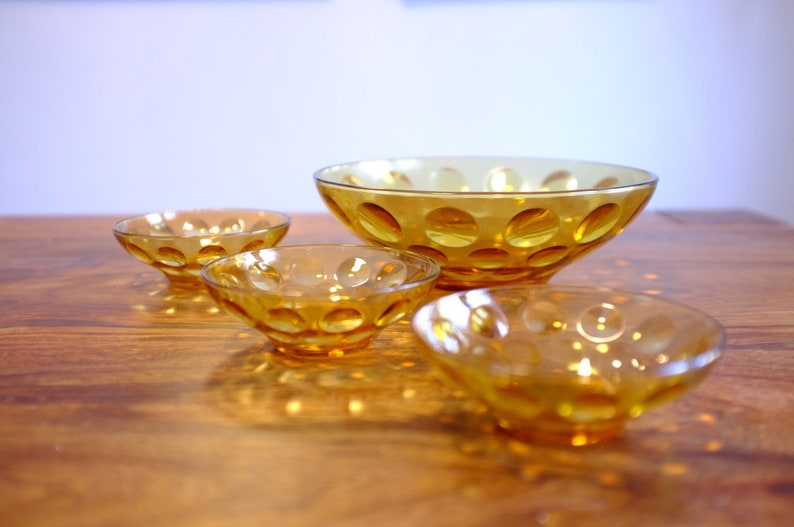 Vintage amber glass bowl with 3 matching serving bowls