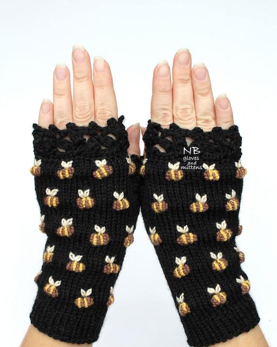 Bienen auf schwarze Handschuhe mit Bienen Hand