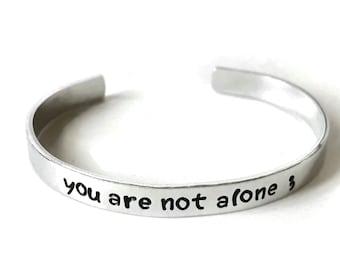 you are not alone metal stamped aluminum cuff bracelet // depression metal health awareness gift semi colon semicolon