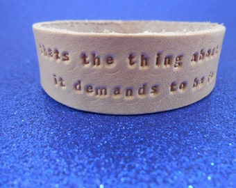 """The Fault in Our Stars - Leather Bracelet - """"That's the thing about pain - it demands to be felt"""""""