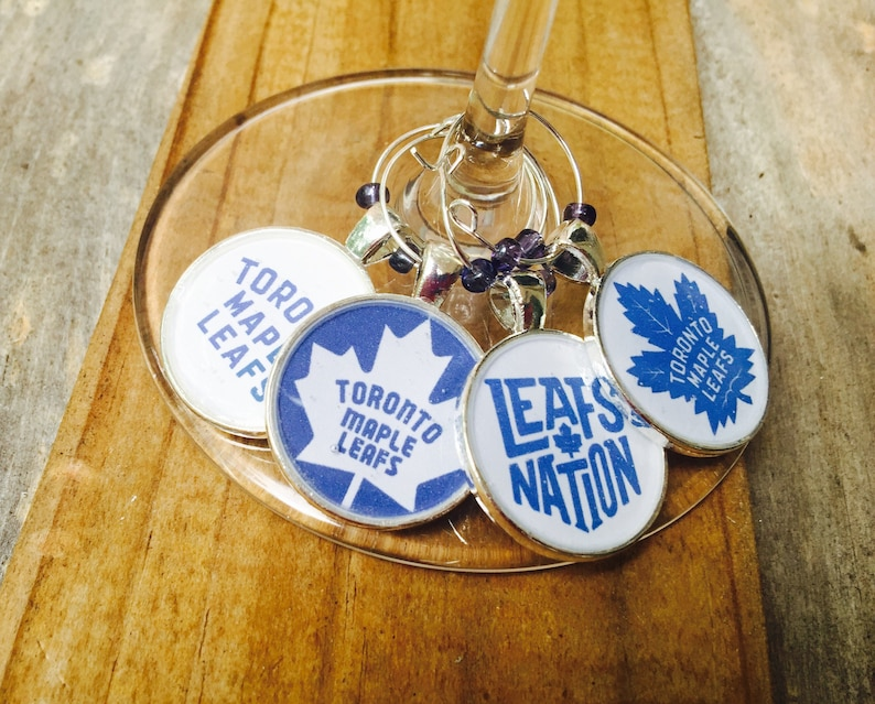 Toronto Maple Leafs NHL Silver Wine Charms set of 4 image 0