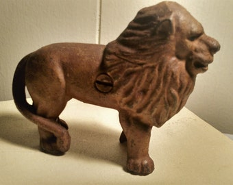 cast iron lion vintage bank or paperweight