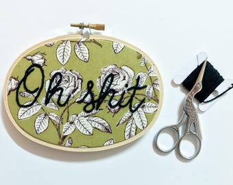cursive 'oh shit' oval hoop