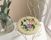 Farmhouse Chic White Metal Chair Plant Stand with Yellow and Floral Ceramic Trivet Insert