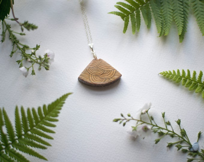 Quarter Branch Necklace with abstract linear pattern.