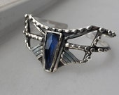 The Arrow cuff - faceted Spectrolite stone cuff in sterling silver