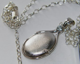 Handcrafted 925 Sterling Silver 4mm Cabochon Sky Blue Topaz Locket H2O Just Add Water Locket