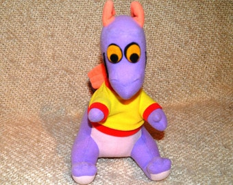 """FIGMENT  WALT  DISNEY Productions  """" 1982 """"  ( 34 yrs. old ) ..He's Purple with Yellow & red Shirt.. Mint Cond. Never Used."""