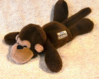 """DISNEY'S ANIMAL KINGDOM """" Monkey """" with Button in his ear that says """"Walt Disney World."""" 18"""" nose to tail. New Wot, owned not used."""
