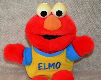 "THAT TICKLES "" & "" Oh Boy."" Elmo talks, 16 1/2"" Tall. Vintage "" 1995."" Yellow and Blue Elmo Shirt. Red Plush."