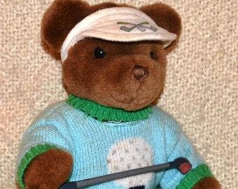 GUND GOLFER Brown BEAR... Wearing a White Visor with Cross Golf Clubs & a Golf Ball, a Blue Golf Sweater and holding a Golf Club, Mint. Cond