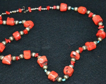 Necklace made of Chunk Coral with gold tone beads.
