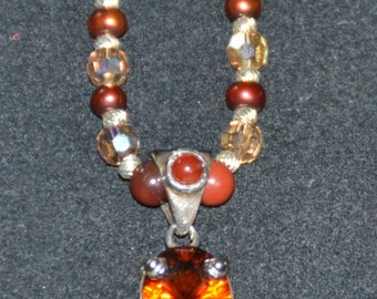 GARNET PENDANT ( orangy red ) STERLING Silver Setting,necklace of Swarovski Crystal and orangy red and gold colored beads.