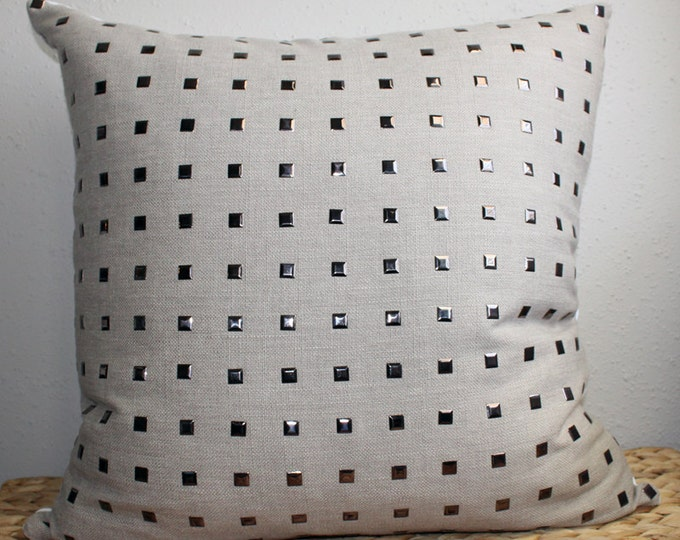 gray studded pillow with pewter metal studs