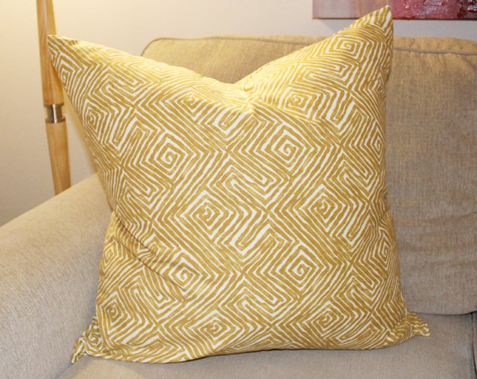 mustard geometric print pillow
