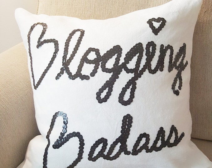 "18"" white ""Blogging Badass"" pillow cover with black sequins"