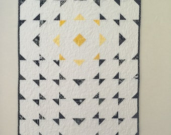 Contemporay Black and White Quilted Wallhanging, with yellow exploded star design.