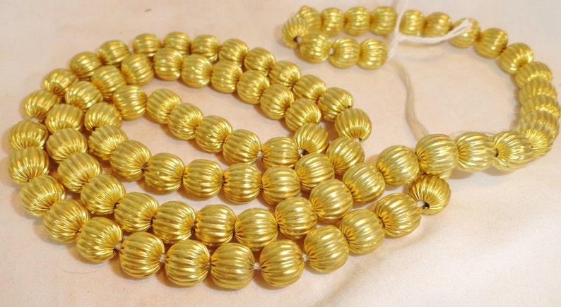 Small African Textured Brass Bead Strands image 0