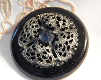 Openwork White Metal with Blue Glass Center Set in a Black Plastic Vintage Coat Button