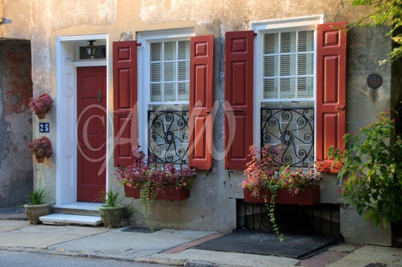 House with red shutters and flower boxes in Charleston, South Carolina