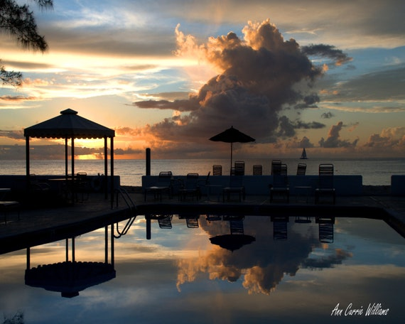 Sunset on Grand Cayman with the colorful reflection in the pool