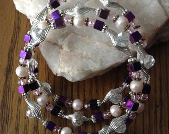 Memory-wire bracelet in clear, pink and passionate purple.